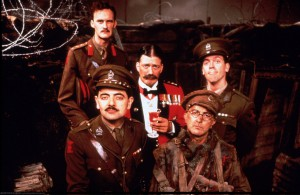 The central cast of Blackadder Goes Forth (back row l/r) Captain Darling - played by Tim McInnerny; General Melchett – Stephen Fry; Lieutenant Barleigh - Hugh Laurie; (front row l-r) Captain Blackadder – Rowan Atkinson, and Private Baldrick – Tony Robinson. (Public domain)