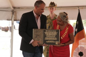 Chief Minister Adam Giles presents a plaque commemorating The Borella Ride to Barbara Shaw, President of the Barkly Regional Council.