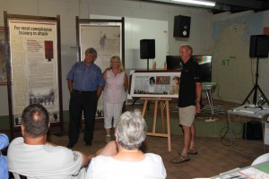 Renner Springs Roadhouse owners Alan and Christine Rendell are presented with their Borella VC memorial board by Rowan Borella, the son of Captain Albert Borella VC