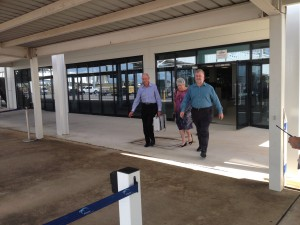 Rowan and Mary Borella arrive at Darwin Airport with the Victoria Cross and medals of Albert Borella. Dr Tom Lewis, Lead Historian for The Borella Ride greets them