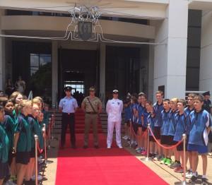 Representatives from the Australian Defence Force wait to receive Albert Borella's Victoria Cross.