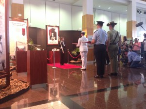 The Victoria Cross is put into the Exhibition cabinets by Serjeant At Arms, Ben Harris.