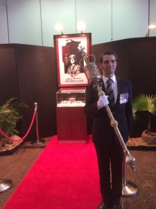 Serjeant At Arms, Ben Harris in front of Albert Borella's Victoria Cross and medal group.