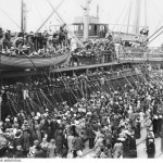 """No. 275 Private Albert """"Bert"""" Borella of the 26th Infantry Battalion embarked on the HMAT Ascanius A11 from Brisbane on the 24th May 1915.   Pictured here is the Ascanius a year later in 1916, embarking from Melbourne. Scenes would like this would have become familiar from many Australian ports, from a population of fewer than five million, 416,809 men enlisted in World War I. (Australian War Memorial)"""